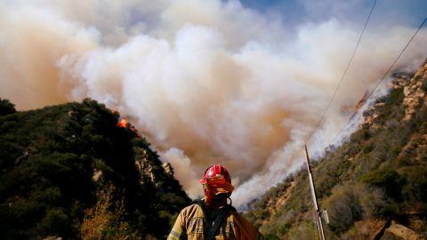 Firefighters battle the Woolsey Fire in Malibu on November 11.