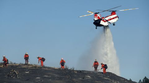 Firefighters put out hot spots in Thousand Oaks on November 12.