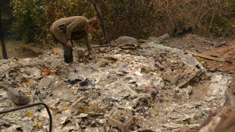 Betsy Ann Cowley walks through Pulga, near where investigators were trying to determine the cause of the Camp Fire.