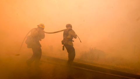 Firefighters battle a fire in Simi Valley on November 12.