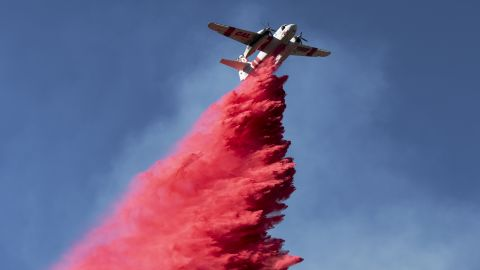 A plane drops fire retardant on the Woolsey Fire near Malibu on November 12.