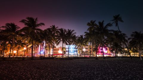 Ocean Drive street with illuminated buildings in Miami , Florida. Vintage colors; Shutterstock ID 539505175; Job: -