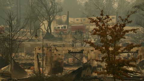 A fire truck drives through part of Paradise on November 13.