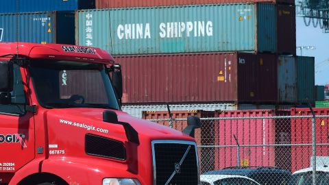 A container delivery truck drives past stacked piles of shipping containers at the Port of Long Beach in Long Beach, California on July 6, 2018, including one from China Shipping, a conglomerate under the direct administration of China's State Council. - The twin ports of Long Beach and Los Angeles in Southern California are fearing a decline in trade could result in loss of jobs as President Trump's trade war has kicked off with tariffs on $34 billion worth of Chinese goods. (Photo by Frederic J. BROWN / AFP)        (Photo credit should read FREDERIC J. BROWN/AFP/Getty Images)