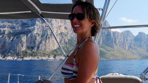 Kellie at the helm of Boomerang, sailing along the north coast of Sicily. We were motor-sailing which means one sail was being augmented by the engine to keep a constant speed of sknots.