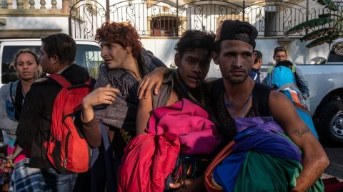 Lesbian, gay, bisexual and transgender migrants say they split from a larger caravan of Central American migrants after facing discrimination. They arrived in Tijuana on Sunday.