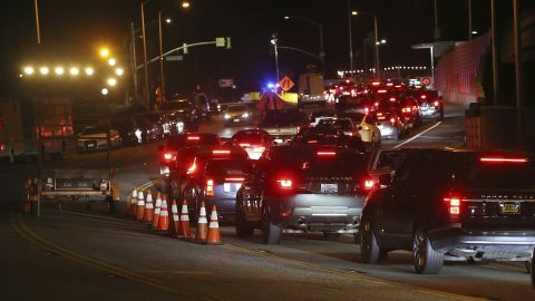 A long line of residents seeking to return to Malibu wait at a checkpoint on November 13 on Pacific Coast Highway after Woolsey Fire evacuation orders were lifted for the eastern portion of the city.