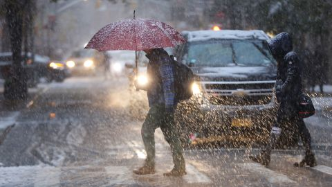 Pedestrians push through a wintry mix of snow and ice Thursday in New York.