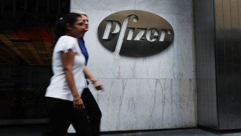 NEW YORK, NY - JULY 11: People pass the Pfizer headquarters  in Manhattan on July 11, 2018 in New York City. A day after President Donald Trump pressured the pharmaceutical giant with a critical tweet, Pfizer has agreed to reverse or postpone drug price hikes. (Photo by Spencer Platt/Getty Images)