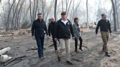 From left, California Gov.-elect Gavin Newsom, California Gov. Jerry Brown, President Donald Trump, Paradise Mayor Jody Jones and FEMA Administrator Brock Long survey damage left by the Camp Fire in Paradise, California, on Saturday, November 17. The death toll from the Camp Fire has risen to 76 and more than 1,200 people remain unaccounted for.