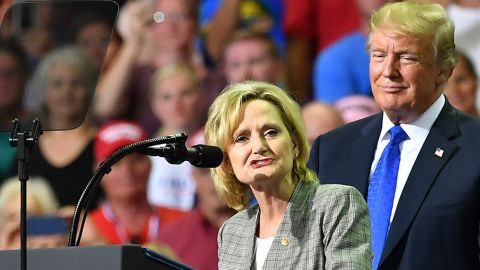 """Senator Cindy Hyde-Smith (L) stands on stage with US President Donald Trump at a """"Make America Great Again"""" rally at Landers Center in Southaven, Mississippi, on October 2, 2018. (Photo by MANDEL NGAN / AFP)        (Photo credit should read MANDEL NGAN/AFP/Getty Images)"""