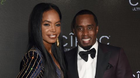 """Kim Porter and recording artist Sean """"Diddy"""" Combs."""