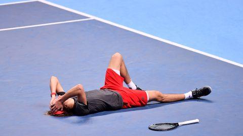Alexander Zverev sunk to the court after winning the World Tour Finals Sunday.