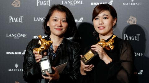 """Taiwanese director Fu Yue (right) poses backstage after winning Best Documentary for her movie """"Our Youth in Taiwan"""" at the 55th Golden Horse Awards in Taipei on November 17, 2018."""