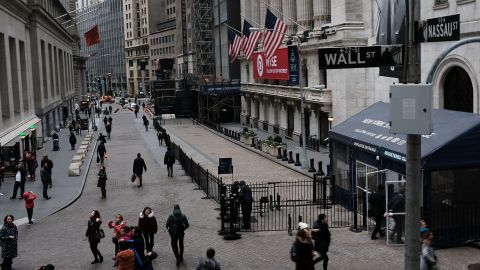 NEW YORK, NY - NOVEMBER 20:  People walk by the New York Stock Exchange (NYSE) on November 20, 2018 in New York City. Stocks fell again on Tuesday morning with the Dow Jones Industrial average plunging over 400 points after the opening bell.