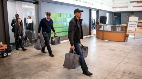 Obama carries donated food on Tuesday to the Greater Chicago Food Depository.