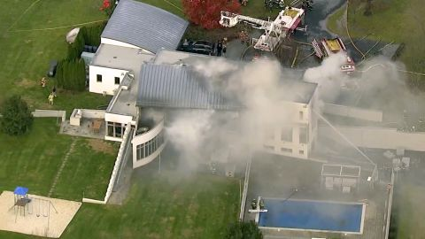 In this image made from a video provided by WABC firefighters battle a fatal fire on Tuesday, Nov. 20, 2018, in Colts Neck, N.J. The Monmouth County prosecutor's office says the fire has taken multiple victims.