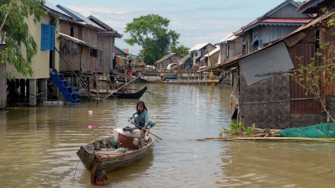 Communities living on the river are vulnerable to flooding, particularly during the monsoon season. In 2013, floods in Cambodia left more than 80 dead and wreaked havoc in villages like this one in Kandal province.<br />