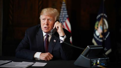 US President Donald Trump speaks to members of the military via teleconference from his Mar-a-Lago resort in Palm Beach, Florida, on Thanksgiving Day, November 22, 2018. (MANDEL NGAN/AFP/Getty Images)