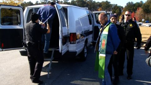 Pastor May was among the dozens of people arrested Friday.