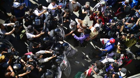 Migrants clash with law enforcement near the US-Mexico border in Tijuana.