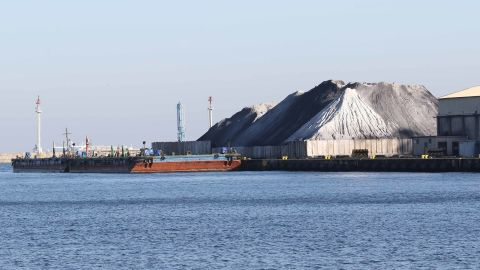 Waste coal piles in Gdynia, Poland, October 2018. Waste coal is sometimes used in domestic stoves to heat Polish homes, contributing to smog.