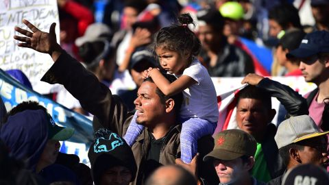 Migrants are stopped by Mexican police officers before arriving at the port of entry.