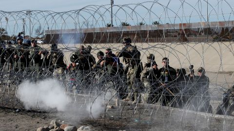 U.S. soldiers and U.S. border patrols fire tear gas towards migrants, part of a caravan of thousands traveling from Central America en route to the United States, from the U.S.side of the border fence between Mexico and the United States in Tijuana, Mexico, November 25, 2018. REUTERS/Kim Kyung-Hoon