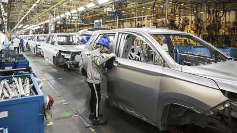 An employee inspects a vehicle in the weld shop at the SAIC-GM-Wuling Automobile Co. Baojun Base plant, a joint venture between SAIC Motor Corp., General Motors Co. and Liuzhou Wuling Automobile Industry Co., in Liuzhou, Guangxi province, China, on Wednesday, May 23, 2018. GM and its partners sold 4 million vehicles in China in 2017, about 1 million more than the automaker sold in the U.S.