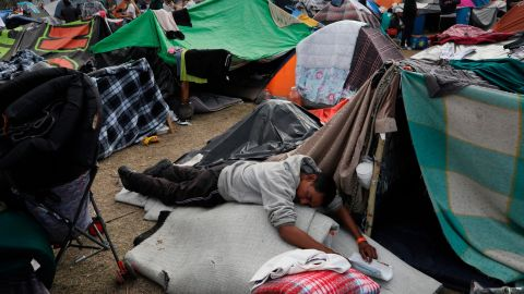 A Central American migrant naps at the Benito Juarez Sports Center serving as a temporary shelter for Central American migrants, in Tijuana, Mexico, Saturday, Nov. 24, 2018. The mayor of Tijuana has declared a humanitarian crisis in his border city and says that he has asked the United Nations for aid to deal with the approximately 5,000 Central American migrants who have arrived in the city.