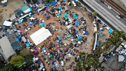 TIJUANA, MEXICO - NOVEMBER 24:  An aerial view of the temporary shelter set up for members of the 'migrant caravan', with a section of the U.S.-Mexico border barrier visible (TOP R),  on November 24, 2018 in Tijuana, Mexico. Around 6,000 migrants from Central America have arrived in the city with the mayor of Tijuana declaring the situation a 'humanitarian crisis'. Most migrants in the caravan say they plan to petition for asylum in the U.S. The incoming government in Mexico will reportedly support a new Trump administration policy requiring migrants asking for asylum in the U.S. to remain in Mexico while their cases are processed.