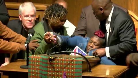 April Pipkins collapses into the arms of attorney Benjamin Crump on Tuesday night at the 16th Street Baptist Church in Brimingham, Alabama.