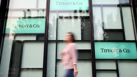 A pedestrian walks past a Tiffany and Co. boutique in Shanghai, China, 15 October 2010.