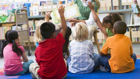 Students in class volunteering for teacher; Shutterstock ID 77123365; Job: -