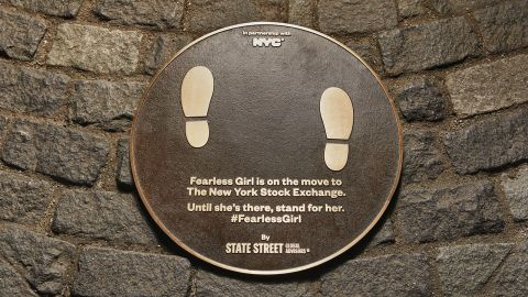 A plaque has been installed where the statue used to be.