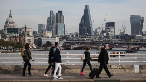 Pedestrians waling through Waterloo Bridge with the skyline of the City of London in the background on October 27, 2016.  Britain's economy won a double boost on October 27 on news of faster-than-expected growth following its vote for Brexit and a pledge by Nissan to build new car models in the UK. Gross domestic product expanded by 0.5 percent in the third quarter, official data showed.  / AFP / Daniel Leal-Olivas        (Photo credit should read DANIEL LEAL-OLIVAS/AFP/Getty Images)