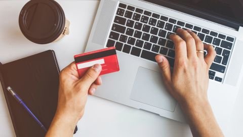 Top view of man using credit card for online shoping; Shutterstock ID 1020500191; Job: -