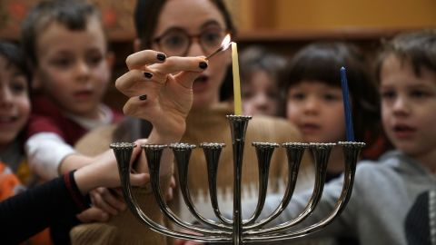 A small group of pre-schoolers from Gan HaYeled learn how to light a Hanukkah menorah from Rabbi Sarah Krinsky at Adas Israel Congregation November 30, 2018 in Washington, DC. This year, Hanukkah will begin at sundown on December 22 and last until sundown on December 30.