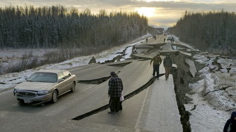 In this photo provided by Jonathan M. Lettow, people walk along Vine Road after the earthquake.
