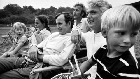 Bush sits with members of his family in 1971. He met his wife at a country club dance in 1941, and they were married in 1945. They had six children.