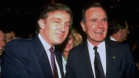 Bush poses for a photo with real estate mogul and future President Donald Trump during a campaign event in 1988.