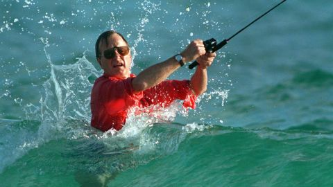 Shortly after winning the election, Bush casts a line while surf fishing in Gulf Stream, Florida.