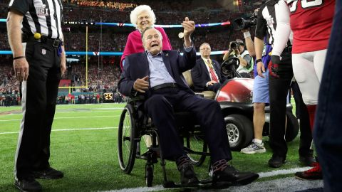 The Bushes participate in the ceremonial coin toss before the Super Bowl in 2017.