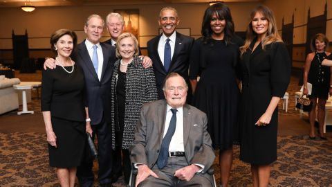 Bush joins former presidents and first ladies at the funeral ceremony for his wife in April 2018. Behind Bush, from left, are Laura Bush, George W. Bush, Bill Clinton, Hillary Clinton, Barack Obama, Michelle Obama and current first lady Melania Trump.