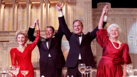 The Reagans and the Bushes join hands after President Reagan endorsed Bush's presidential run at a dinner in 1988.