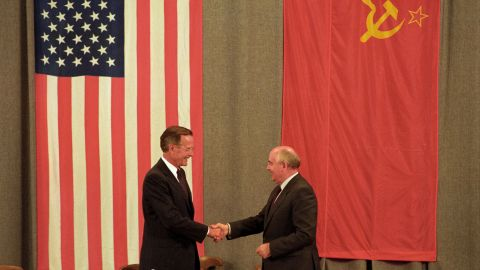 Bush and Gorbachev shake hands at the end of a news conference in Moscow in July 1991.