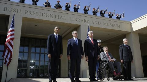 Bush, in the wheelchair, arrives for the dedication of his son's presidential library in Dallas in 2013. Joining him, from left, are President Barack Obama and former Presidents George W. Bush, Bill Clinton and Jimmy Carter.