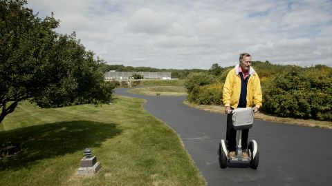 Bush rides a Segway at his home in Kennebunkport, Maine, in 2003.