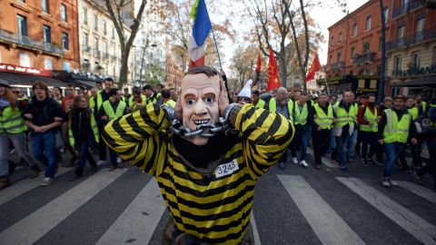 A false Macron shut his ears as people shout 'Macron, demission'. Protesters called 'Gilets jaunes' (ie Yellow vests) protest against the rise of taxes on oil products. They organized themselves by social networks to block roads, accesses to airports, etc. Mostly said that the rise of taxes on oil products was the detonator of their wrath against French President Macron and his governement. Toulouse. France. November 17th 2018. (Photo by Alain Pitton/NurPhoto via Getty Images)