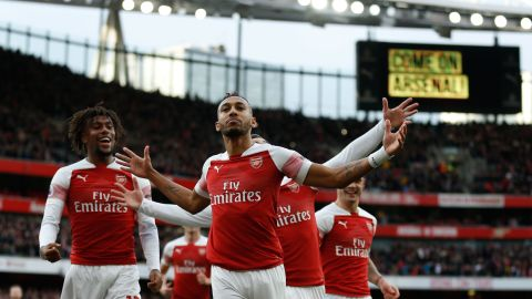 Arsenal's Pierre-Emerick Aubameyang celebrates after scoring the opening goal from the penalty spot during Arsenal's EPL encounter with Tottenham Hotspur at the Emirates Stadium.